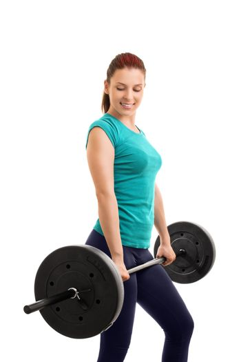 Work it, feel it, love it. It's your figure. Beautiful young girl holding a barbell, isolated on white background. Ready for some deadlifts.