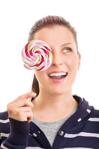 Lollipop wink. Beautiful young girl holding a colorful lollipop, isolated on white background.