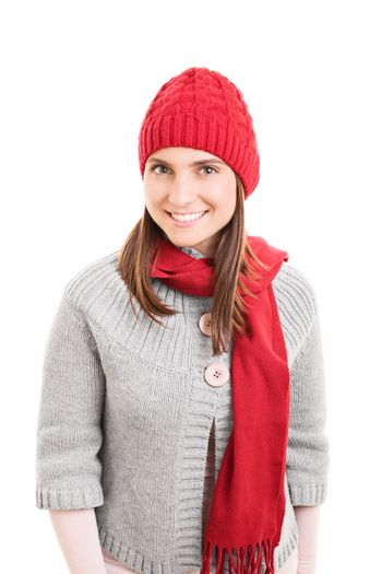 Portrait of a beautiful smiling young girl wearing warm red winter scarf and beanie, isolated on white background.