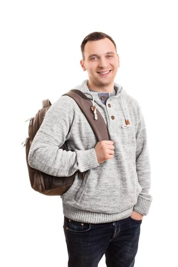 A portrait of a young male student with a backpack, isolated on white background.