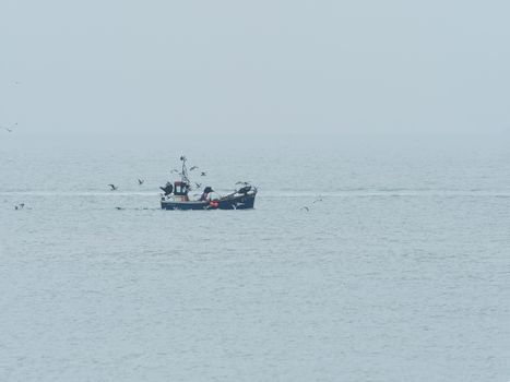Fishing Boat on Misty Day