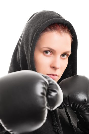 Close up shot of a beautiful young female boxer with a hoodie and boxing gloves, isolated on white background.