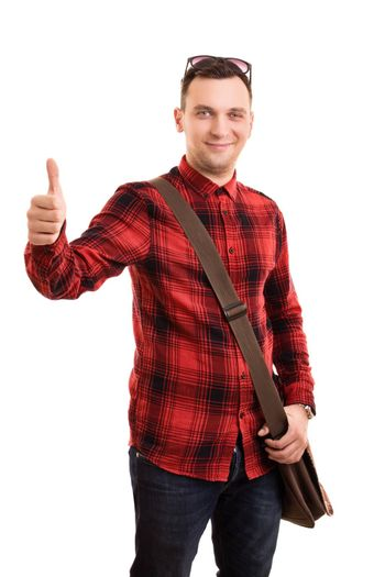 A portrait of a male student with a shoulder bag giving a thumbs up, isolated on white background.