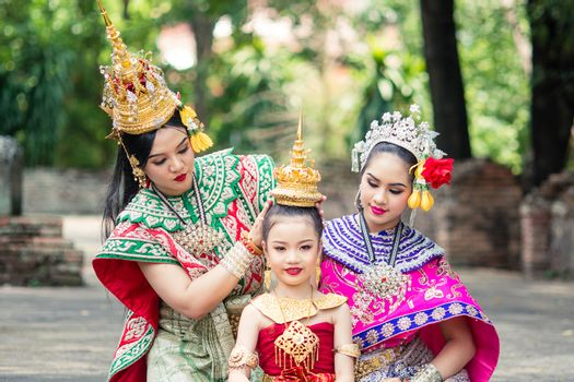 """Asian woman wearing typical, traditional Thai Dress. It is literally means """"Thai outfit"""", National costume."""