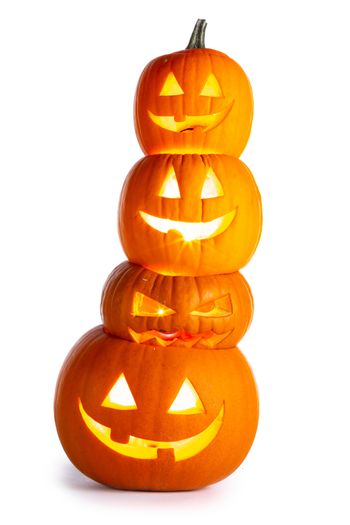 Stack of glowing Halloween Pumpkins isolated on white background