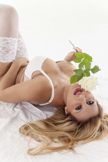 blonde woman in underwear with a rose