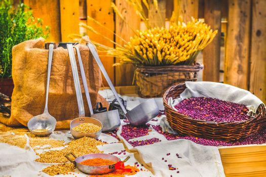 barn building interior table with cereals grains ladle farm granary traditional legumes agricultural rural background .