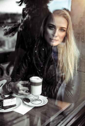 Sad woman in the cafe