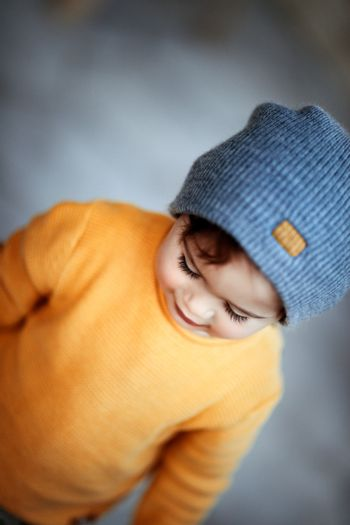 Cute baby boy wearing stylish warm clothes, kids fashion, autumn season, cute trendy little child