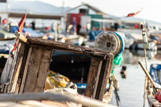 a shoot from a fisherman bay - there is some wooden boxes with blurry background. photo has taken at izmir/turkey.