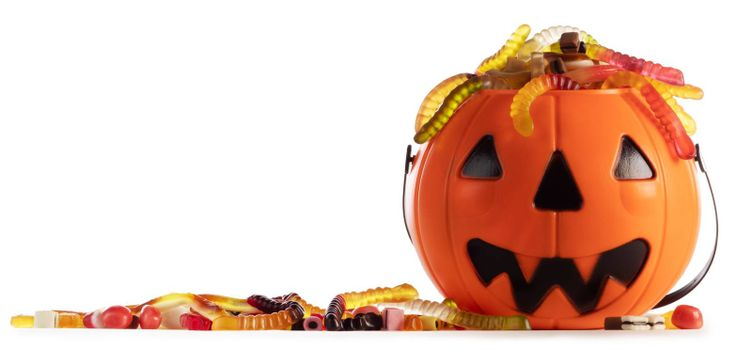 Sweets gummy worms candies in Halloween bag basket jack o lantern pumpkin isolated on white background