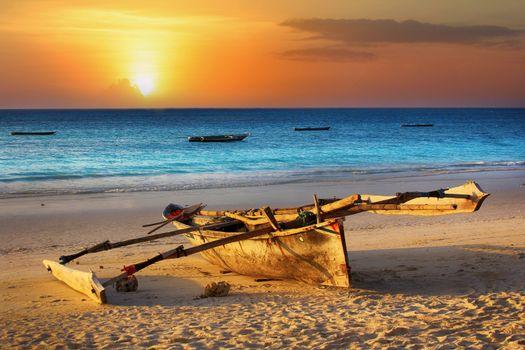 Traditional fishing boat on the ocean at sunset. Zanzibar
