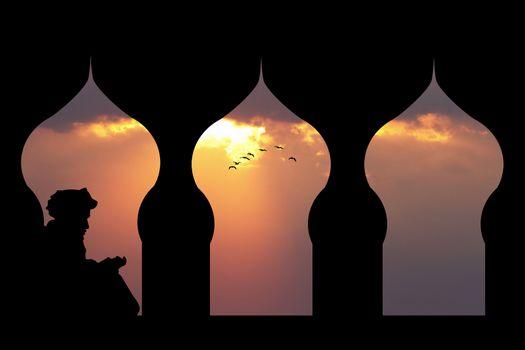 Islamic man reads the Koran at sunset