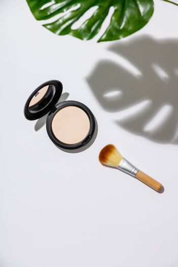 Face powder and brush for makeup, flat lay