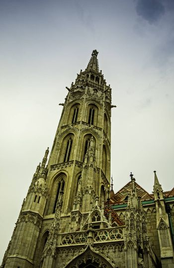 Bottom up view of the spire of Matthias Church in the Fisherman's Bastion in Budapest.
