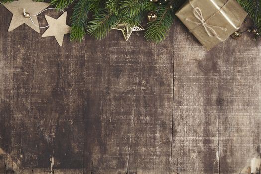 Christmas theme background in vintage tone. Rustic wood background for Christmas with copy space for all Christmas design. Old wood texture decorated with Christmas decoration theme for wallpaper and product display in Christmas time.