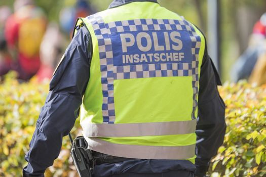 Swedish Police task force commander with Reflective Vest.