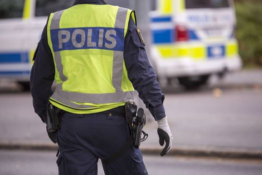 Swedish Police Officer with Reflective Vest and gun
