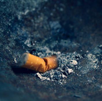 Burning cigarettes with smoke