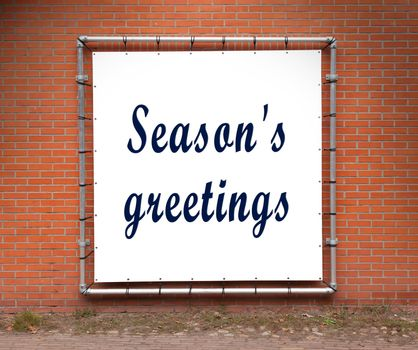 Large message written on a wall - Season's greetings