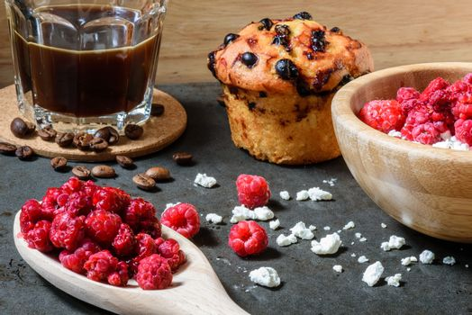 Curd with raspberries, coffee in a cup and blueberry muffin for breakfast