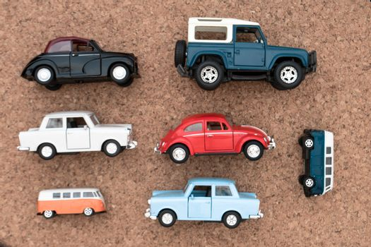 Flat lay of different nostalgic toy cars in various colors