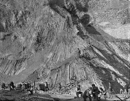 Basalt extraction on the banks of the Rhine, vintage engraved illustration. From the Universe and Humanity, 1910.