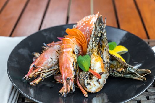 seafood platter delicious grilled prawn; rock lobster and red crab