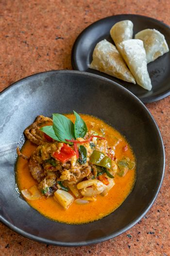 Curry Soft crab with cheese roti