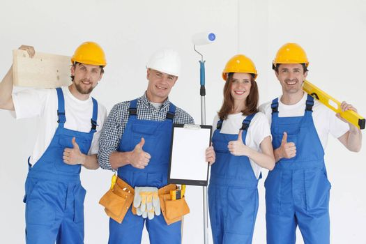 Group of professional industrial workers with tools and contract