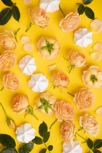 Floral pattern with pink roses and merengues on yellow background