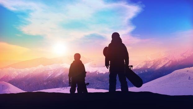 Father and son on the slope of the snowboard track.