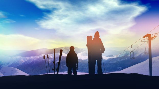 Father with son on the slope of the ski run.