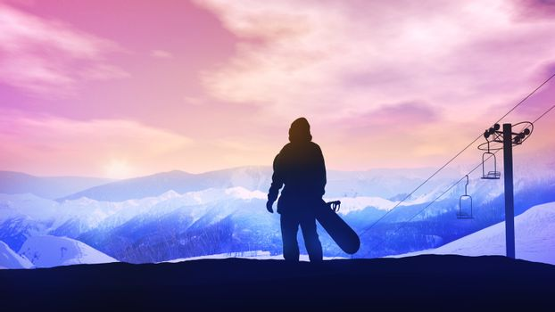 Snowboarder on the background of a bright sunset in the mountains.