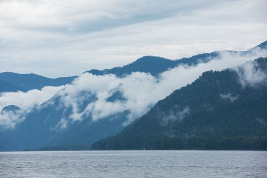 Foggy Teletskoye lake in Altai mountains