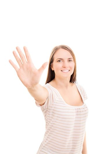 Beautiful smiling young girl holding her hand up making a high five gesture, isolated on white background.