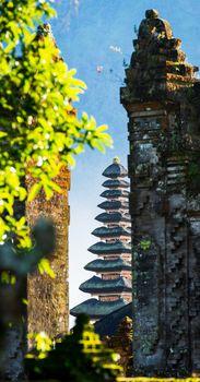 Pura Ulun Danu Beratan temple seen through a stone gate in Bali, Indonesia