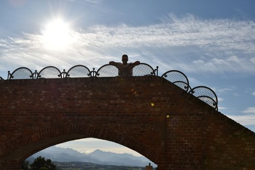 Silhouette of a man in a little bridge