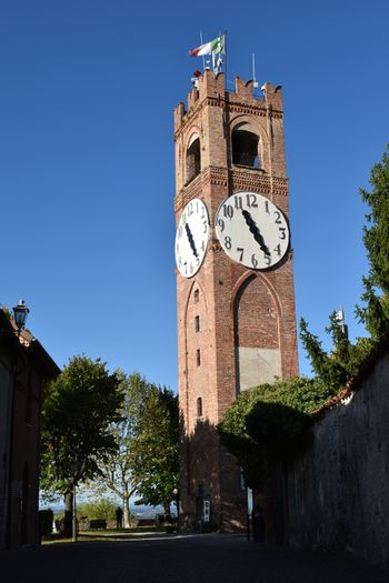 Vertical view of the tower with clock of Mondovi Piazza