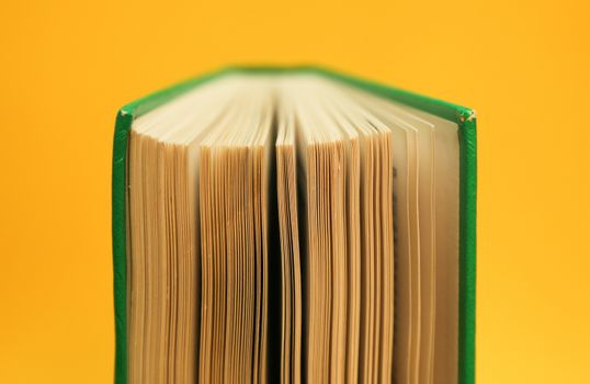 Open book with pages spread. Studying hardcover book