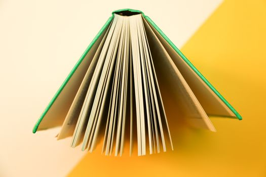 Open book with dual tone background. Hardcover book open pages.