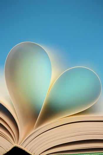 Blue heart, glowing blue heart from book pages.