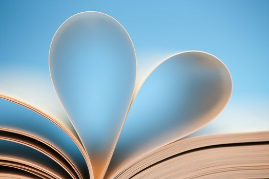 Blue heart book, page forming heart - love of reading books.