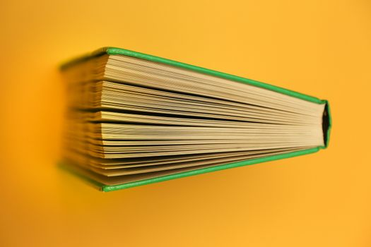Yellow background, bright book top down. Literature pages spread textbook.