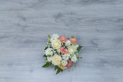 Garden flowers over grey wooden table background. Backdrop with copy space.