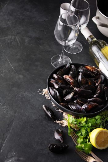 Bowl with fresh raw mussels with white wine, lemon and parsley