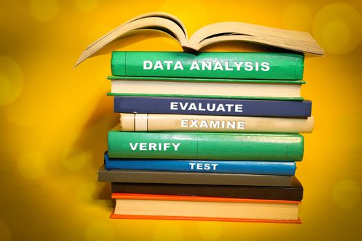 Data Analysis with various themed Data Analysis words on book spine