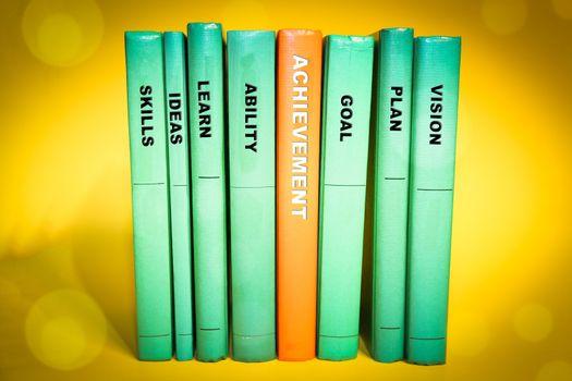 Achievement concept on books spine, various keywords