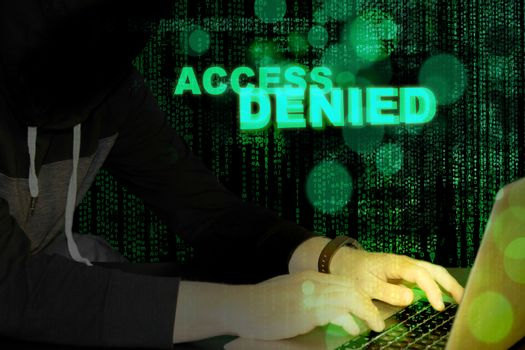 Access denied - hacker and laptop with code background
