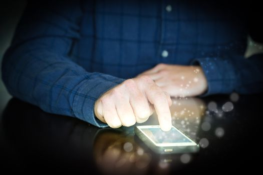 Mobile phone, using a touch screen, sparks around the phone.